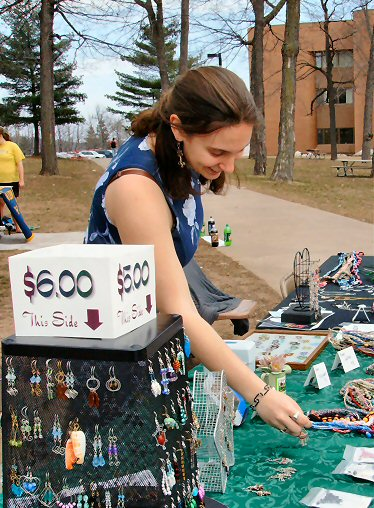 Rebecca Rudaski, arranging her table at Spring Fling on the Michigan Tech campus in the beautiful 